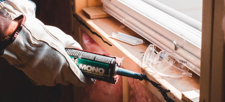 worker applying sealant
