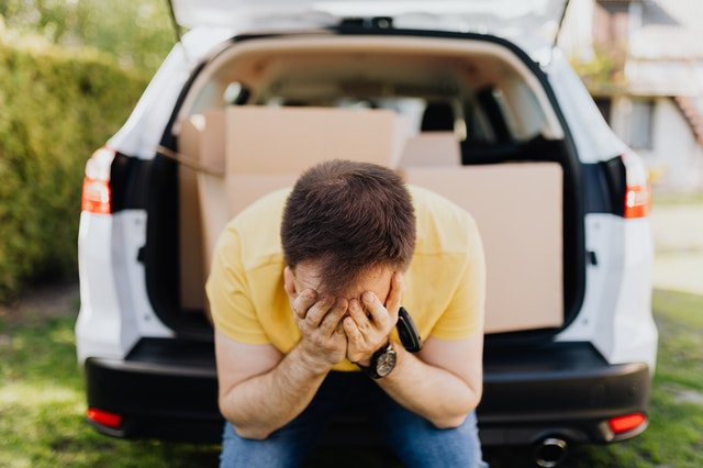 a man stressed out while moving house