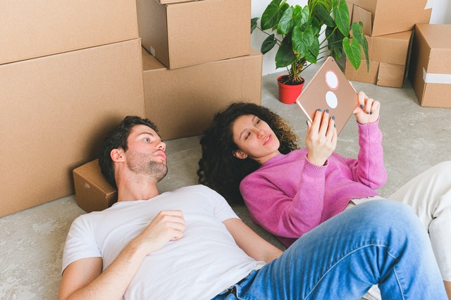 a couple using a tablet to find moving companies